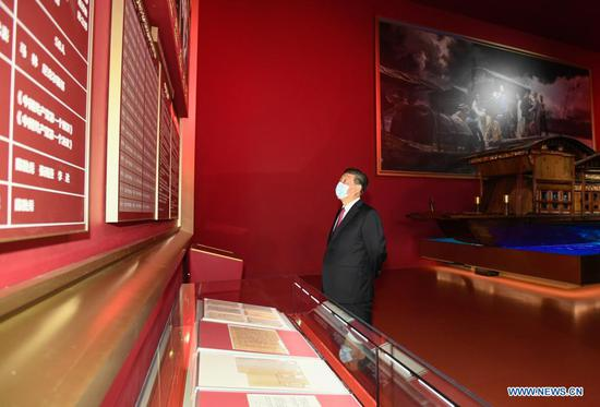 Chinese President Xi Jinping, also general secretary of the Communist Party of China (CPC) Central Committee and chairman of the Central Military Commission, visits an exhibition on CPC history themed