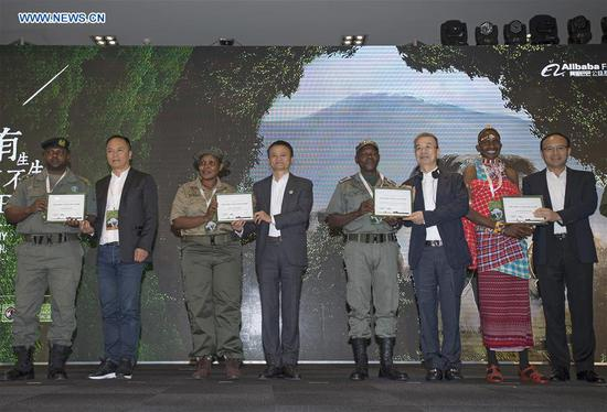 Jack Ma (4th L), Executive Chair of Alibaba Group and Co-chair of the Paradise Foundation presents an award to an African ranger during the 2018 Ranger Awards ceremony in Cape Town, South Africa, on Aug. 7, 2018. The African Ranger Awards was launched by the Alibaba Foundation together with the Paradise Foundation in July this year. Under the initiative that will last 10 years, 50 wildlife rangers will be awarded each year, with a prize of 3,000 U.S. dollars each. (Xinhua/Chen Cheng)