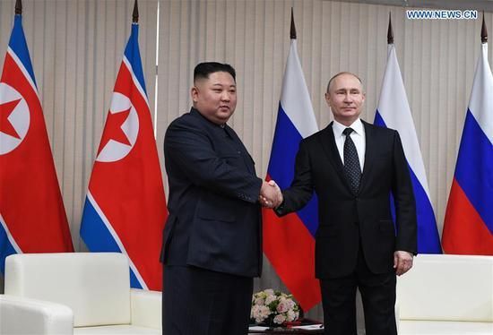 Russian President Vladimir Putin (R) shakes hands with top leader of the Democratic People's Republic of Korea (DPRK) Kim Jong Un in Vladivostok, Russia, April 25, 2019. (Xinhua/Sputnik)