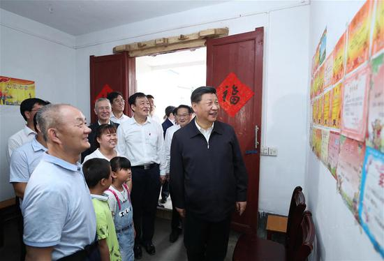 Chinese President Xi Jinping, also general secretary of the Communist Party of China Central Committee and chairman of the Central Military Commission, visits Tantou Village in Yudu County, Ganzhou City, during an inspection tour of east China's Jiangxi Province on May 20, 2019. At the home of veteran Sun Guanfa, a descendant of a Red Army martyr, Xi chatted with Sun's family. (Xinhua/Ju Peng)
