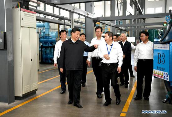 Chinese President Xi Jinping, also general secretary of the Communist Party of China Central Committee and chairman of the Central Military Commission, learns about the production process and operation of the JL MAG Rare-Earth Co. Ltd. as well as the development of the rare earth industry in the city of Ganzhou in east China's Jiangxi Province on May 20, 2019. Xi Jinping visited Jiangxi Province Monday on an inspection tour. (Xinhua/Xie Huanchi)
