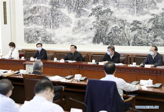 Wang Chen, a member of the Political Bureau of the Communist Party of China Central Committee and vice chairman of the Standing Committee of the National People's Congress (NPC), attends an NPC Standing Committee meeting on the research for the formulation of China's outline of the 14th five-year (2021-2025) plan for economic and social development in Beijing, capital of China, June 2, 2020. (Xinhua/Ding Haitao)