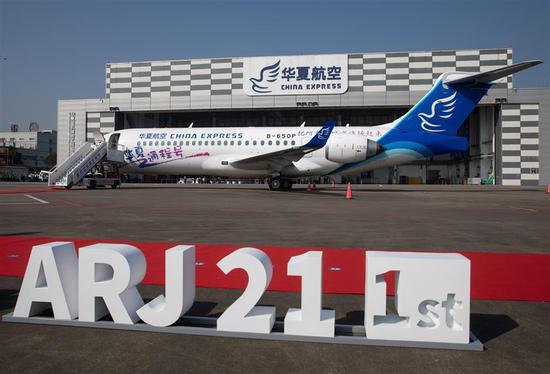 An ARJ21 regional jetliner is parked at Chongqing Jiangbei International Airport on November 10, 2020.