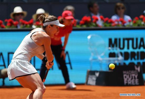 Simona Halep of Romania competes during the women's individuals round 16 match against Kristyna Pliskova of the Czech Republic at the Madrid Open Tennis tournament in Madrid, Spain, May 9, 2018. Simona Halep won 2-0. (Xinhua/Guo Qiuda)