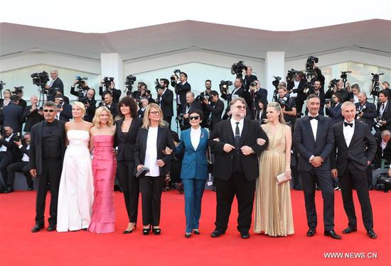 Competition jury president Guillermo Del Toro (4th R) and Kim Morgan (3rd R), and jury members pose on the red carpet of the 75th Venice International Film Festival in Venice, Italy, Aug. 29, 2018. The 75th Venice International Film Festival kicked off here on Wednesday. (Xinhua/Cheng Tingting)