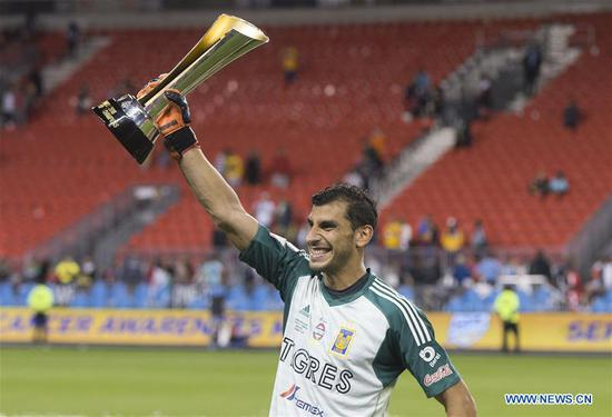 Goalkeeper Nahuel Guzman of Mexico's Tigres UANL celebrates victory with trophy during the awarding ceremony of the inaugural Campeones Cup match between Canada's Toronto FC and Mexico's Tigres UANL at BMO Field in Toronto, Canada, Sept. 19, 2018. Mexico's Tigres UANL won 3-1 and claimed the title. The Campeones Cup, established in 2018, is an annual North American soccer competition contested between the champions of the previous Major League Soccer season and the winner from Liga MX. (Xinhua/Zou Zheng)
