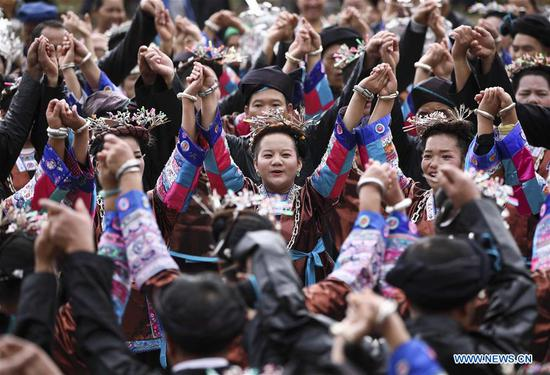 People dance during a harvest festival in Dongtou Village, Rongshui Miao Autonomous County, south China's Guangxi Zhuang Autonomous Region, Oct. 26, 2018. Local people celebrated harvest Friday through various activities like fish feast, singing and playing lusheng. (Xinhua/Lan Hongguang)