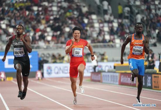 Su Bingtian (C) of China competes during the men's 100m semi-final at the 2019 IAAF World Athletics Championships in Doha, Qatar, on Sept. 28, 2019. (Xinhua/Li Gang)