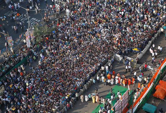 People attend a protest march against the National Register of Citizens and a new citizenship law in Kolkata, India, on Wednesday.