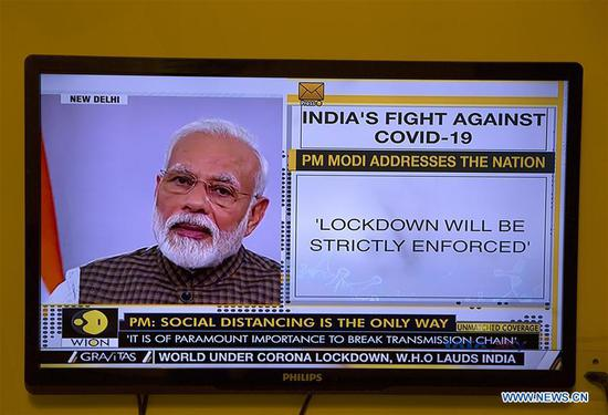 "Photo taken on March 24, 2020 shows Indian Prime Minister Narendra Modi addressing people on television in New Delhi, India. In a bid to fight against the COVID-19 pandemic, Indian Prime Minister Narendra Modi on Tuesday announced a ""countrywide lockdown"" for 21 days, beginning Tuesday at 2400 hours. (Xinhua/Javed Dar)"