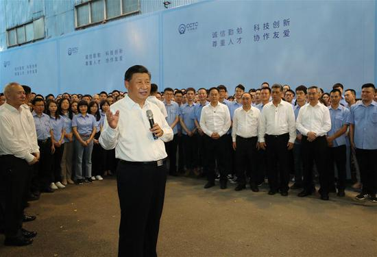 Chinese President Xi Jinping, also general secretary of the Communist Party of China Central Committee and chairman of the Central Military Commission, speaks with staff members while visiting Chaozhou Three-Circle (Group) Co., Ltd. in Chaozhou, south China's Guangdong Province, Oct. 12, 2020. Xi on Monday arrived in Guangdong to begin an inspection tour of the province. (Xinhua/Ju Peng)