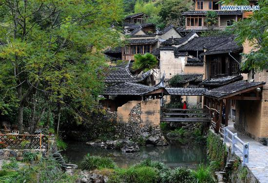 Photo taken on Oct. 21, 2020 shows a view of the home inns in Longtan Village of Pingnan County in Ningde City, southeast China's Fujian Province. Longtan Village had been a provincial-level poverty-stricken village due to lack of arable land. Villagers went out for work one after another with many old buildings left in disrepair. In 2017, the county government launched a project to boost ancient villages through cultural and creative industries. The old houses, once forgotten, have been connected to public utilities, reinforced and decorated inside, with the ancient appearance of the village remained. Moreover, the renaissance here has attracted many people and college graduates outside the village to work here. Nowadays, more and more people come to visit Longtan since the village has become popular on the Internet. (Xinhua/Wei Peiquan)