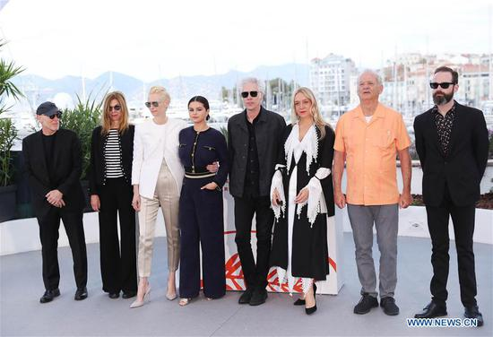 Director Jim Jarmusch (4th R) and cast members of