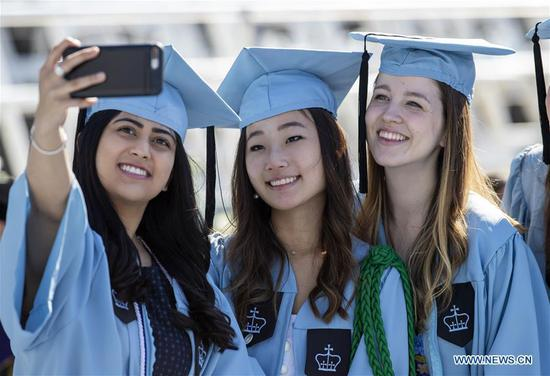 Graduate students take a selfie before the Columbia University Commencement ceremony in New York, the United States, May 22, 2019. The Columbia University Commencement ceremony of the 265th academic year took place on Wednesday. More than 17,000 students from Columbia's 18 schools and affiliates graduated this year. (Xinhua/Wang Ying)