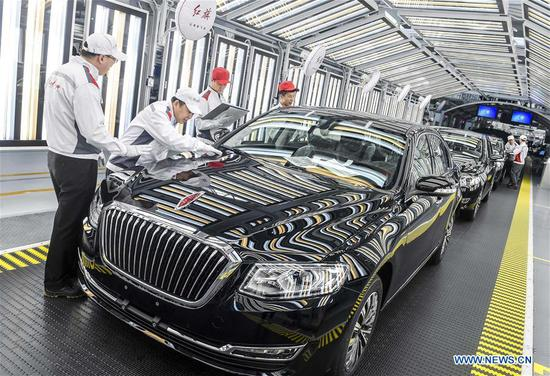 Staff members check FAW's Hongqi cars in an assembly workshop in Changchun, capital city of northeast China's Jilin Province, April 9, 2019. China's GDP expanded 6.3 percent year on year in the first half of 2019 to about 45.09 trillion yuan (about 6.6 trillion U.S. dollars), data from the National Bureau of Statistics showed Monday. The growth was in line with the government's annual target of 6-6.5 percent set for 2019. In the second quarter, the country's GDP rose 6.2 percent year on year, lower than 6.4 percent in the first quarter, according to the data. (Xinhua/Xu Chang)
