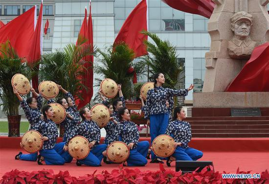 Staff members from Gansu Daily perform dance during an event marking the conclusion of an activity that took journalists to retrace the route of the Long March, in Huining, northwest China's Gansu Province, Aug. 18, 2019. The activity, held from June 11 to Aug. 18, was aimed at paying tribute to the revolutionary martyrs and passing on the traditions of revolution. The Long March was a military maneuver carried out by the Chinese Workers' and Peasants' Red Army from 1934 to 1936. During this period, they left their bases and marched through rivers, mountains and arid grassland to break the siege of Kuomintang forces and continue to fight Japanese aggressors. Many marched as far as 12,500 km. (Xinhua/Luo Xiaoguang)