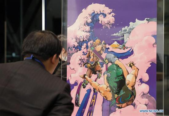 A journalist watches a poster at the preview of Tokyo 2020 Olympics Official Art Poster Exhibition in Tokyo, Japan, Jan. 6, 2020. (Xinhua/Du Xiaoyi)