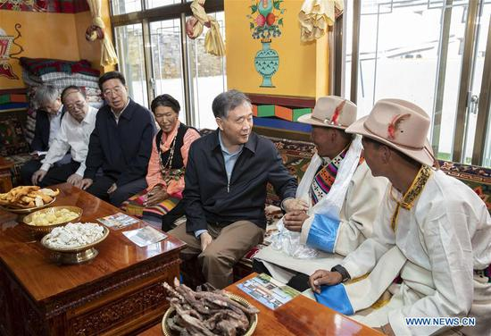 Wang Yang, a member of the Standing Committee of the Political Bureau of the Communist Party of China Central Committee and chairman of the Chinese People's Political Consultative Conference National Committee, talks with local residents at a village relocated for poverty relief in Xigaze, southwest China's Tibet Autonomous Region, July 6, 2020. Wang made a three-day inspection tour that started Monday in the region. (Xinhua/Huang Jingwen)