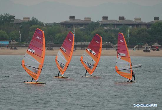 Athletes compete during the women's RS:X class event at 2020 China's National Windsurfing Championships in Qinhuangdao, a coastal city of north China's Hebei Province, Sept. 2, 2020. (Xinhua/Yang Shiyao)