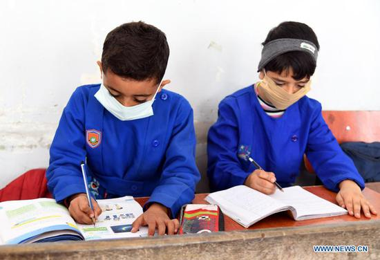Children study at school in Damascus, Syria on Nov. 18, 2020. The globe will mark this year's World Children's Day on Friday. (Photo by Ammar Safarjalani/Xinhua)