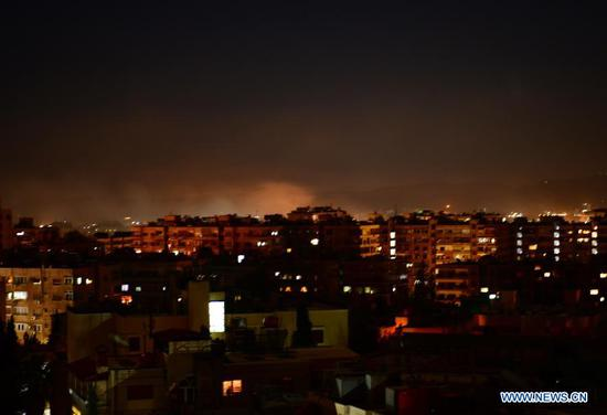 Smoke rises following an Israeli missile attack in Damascus, Syria, on Feb. 28, 2021. A fresh Israeli missile attack targeted positions in the vicinity of Damascus on Sunday night, state TV reported. (Photo by Ammar Safarjalani/Xinhua)