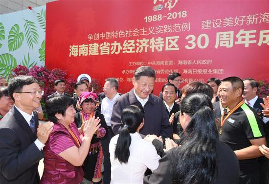 Chinese President Xi Jinping, also general secretary of the Communist Party of China Central Committee and chairman of the Central Military Commission, shakes hands with model workers and representatives of different occupations at a plaza of the Hainan Museum in Haikou, south China's Hainan Province, April 13, 2018. Xi made an inspection tour in Hainan from Wednesday to Friday. (Xinhua/Li Xueren)