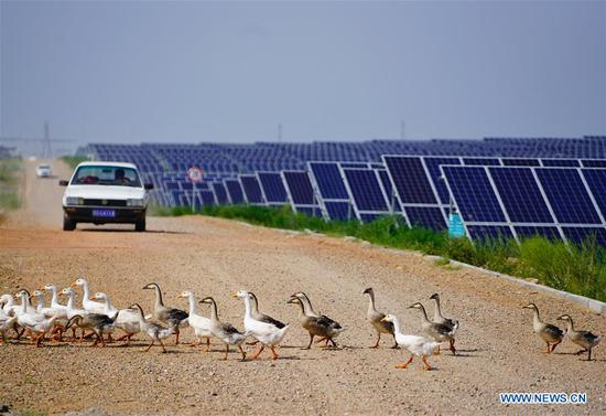 Photo taken on Aug. 1, 2018 shows the solar power farm built at the Kubuqi Desert in north China's Inner Mongolia Autonomous Region. Kubuqi, the seventh largest desert in China, is a good example of China's success in alleviating desertification. About 6,460 square kilometers of the Kubuqi desert has been reclaimed in the last 30 years. (Xinhua/Xing Guangli)
