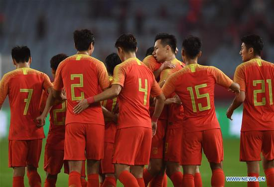Gao Lin (3rd R) of China celebrates after scoring with his teammates during the CFA Team China International Football Match 2018 between China and Syria in Nanjing, capital of east China's Jiangsu Province, Oct. 16, 2018. China won 2-0. (Xinhua/Ji Chunpeng)