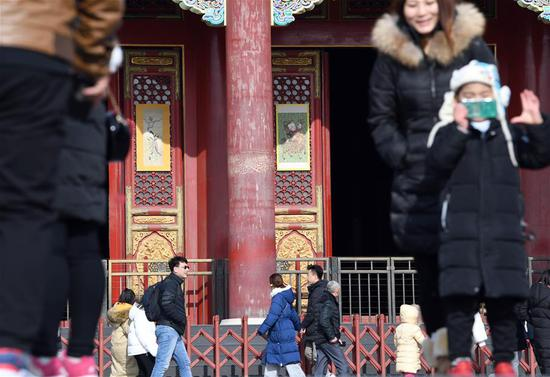 People visit the Palace Museum, also known as the Forbidden City in Beijing, capital of China, Jan. 5, 2019. In celebrating of the most magnificent of all traditional holidays, the Palace Museum presents exhibition of