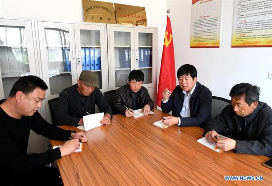 At 2:50 pm, Wang Heying (2nd R), Communist Party branch secretary of Xiaozhai Village, hosts a meeting to discuss environmental protection issues in the village in Xiongan New Area, north China's Hebei Province, April 1, 2019. Known as the China's
