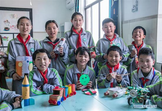Students demonstrate craftwork produced out of recycled materials during an environmental awareness activity marking Earth Day, which falls on April 22, at the Second Primary School in Donglin Township of Huzhou, east China's Zhejiang Province, April 19, 2019. (Xinhua/Xu Yu)