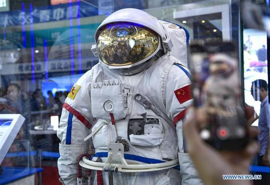 Visitors look at an extravehicular mobility unit (EMU) designed for a taikonaut at an exhibition of high technologies and equipment during the fourth China-Arab States Expo in Yinchuan, northwest China's Ningxia Hui Autonomous Region, Sept. 7, 2019. The fourth China-Arab States Expo has helped promote cross-border high-tech exchange and cooperation. At an exhibition of high technologies and equipment held as part of the expo, visitors are exposed to major scientific and technological breakthroughs and state-of-the-art equipment developed by the high-tech sector. (Xinhua/Feng Kaihua)
