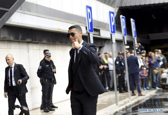 Portugal's national football team player Cristiano Ronaldo gestures while arriving at airport before departing to Russia for the FIFA World Cup 2018 in Lisbon, Portugal, June 9, 2018. (Xinhua/Zhang Liyun)