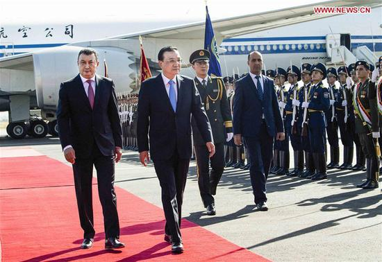 Chinese Premier Li Keqiang, accompanied by Tajik Prime Minister Kokhir Rasulzoda, inspects the guard of honor during a welcome ceremony at the Dushanbe international airport in Dushanbe, Tajikistan, Oct. 11, 2018. Li Keqiang arrived here on Thursday for an annual meeting of heads of government of the Shanghai Cooperation Organization member states and an official visit to Tajikistan. (Xinhua/Li Tao)