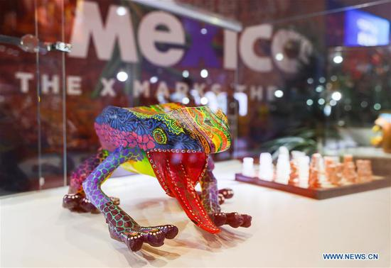 A handicraft is displayed at the Mexico pavilion during the first China International Import Expo (CIIE) in Shanghai, east China, Nov. 5, 2018. A total of 82 countries and three international organizations showcased their achievements in economic and trade development as well as competitive products at 71 booths in the Country Pavilion for Trade and Investment at the CIIE. (Xinhua/Liu Dawei)