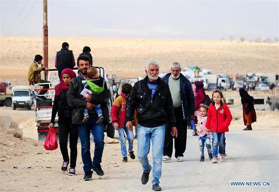 Syrian refugees are seen upon their arrival from Lebanon to Syria at the Zamarani border crossing in the countryside of Damascus, capital of Syria, on Nov. 8, 2018. Over 100 Syrian refugees returned to their homeland on Thursday from several areas in Lebanon including Aarsal, Nabatieh and Tyre, local media reported. (Xinhua/Ammar Safarjalani)