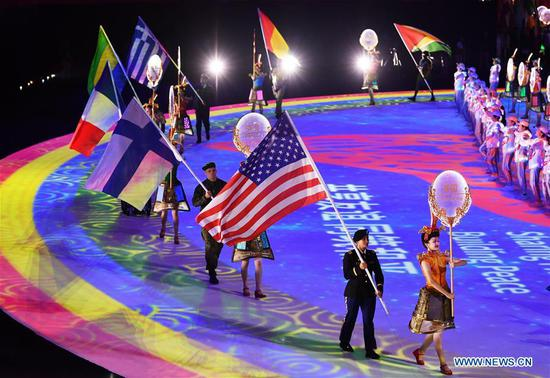 Flag bearers walk into the stadium during the closing ceremony of the 7th CISM Military World Games in Wuhan, capital of central China's Hubei Province, Oct. 27, 2019. (Xinhua/Hu Huhu)