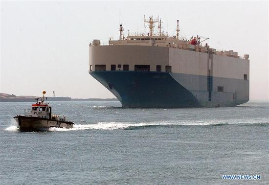 A pilotage ship leads a huge freighter to pass through the Suez Canal in Egypt on Oct. 3, 2007. Egypt's Suez Canal Authority (SCA) celebrated on Sunday the 150th anniversary of the Suez Canal's opening to international navigation. The Suez Canal is an artificial sea-level waterway in Egypt, connecting the Mediterranean Sea and the Red Sea. It was opened for navigation in November 1869 after 10 years of construction. The Suez Canal is one of the most important waterways in the world since it allows ships to travel between Europe and South Asia without navigating around Africa, thereby reducing the sea voyage distance between Europe and India by about 7,000 km. In August of 2015, Egypt opened a new 35-km waterway alongside the original 190 km Suez Canal, plus a 37-km expansion and deepening of some parts of the existing one. (Xinhua/Lin Yiguang)