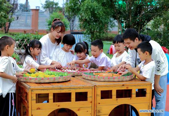 Children make pictures with crops during an event held ahead of farmers' harvest festival in Changxing, east China's Zhejiang Province, Sept. 21, 2020. The third Chinese farmers' harvest festival falls on Sept. 22, 2020. (Xinhua/Xu Yu)