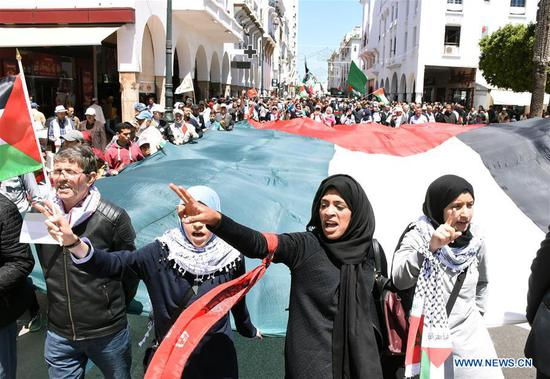 People march to commemorate the upcoming Nakba Day in Rabat, Morocco, on May 13, 2018. Thousands of people marched Sunday here to commemorate the upcoming Nakba Day, or
