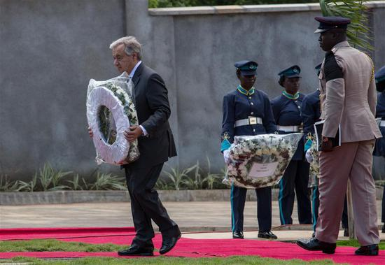United Nations Secretary-General Antonio Guterres (1st L) lays a wreath for his late colleague Kofi Annan during Annan's state funeral in Accra, Ghana, on Sept. 13, 2018. A number of African and world leaders joined Ghanaian President Nana Akufo-Addo here on Thursday to bid farewell to former United Nations Secretary-General Kofi Annan, who passed away in Switzerland on Aug. 18. (Xinhua/Fred Bonsu)