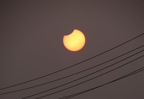 A partial solar eclipse is observed as the moon passes in front of the sun in Dashu Township of Zoucheng City, east China's Shandong Province, Jan. 6, 2019. (Xinhua/Wang Qisheng)