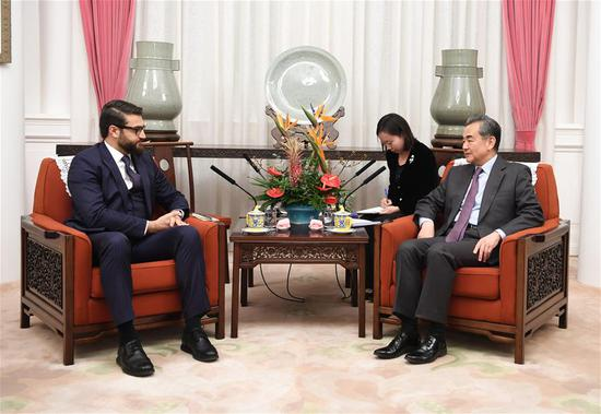 Chinese State Councilor and Foreign Minister Wang Yi (R) meets with Afghan president's national security adviser Hamdullah Mohib in Beijing, capital of China, Jan. 10, 2019. (Xinhua/Zhang Ling)