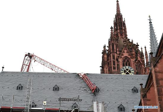 Photo taken on Feb. 10, 2020 shows the damaged roof of the cathedral in Frankfurt, Germany. The cathedral in Frankfurt was damaged when the jib of a building crane torn down by hurricane-force winds buckled and crashed into the roof of the cathedral. Storm Ciara, known as Storm Sabine in Germany, swept over Germany and caused severe disruptions to road, rail and air traffic over the past two days. (Xinhua/Lu Yang)