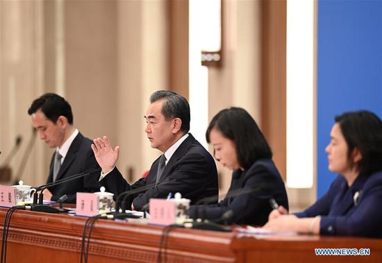 Chinese State Councilor and Foreign Minister Wang Yi (2nd L) attends a press conference on China's foreign policy and foreign relations via video link on the sidelines of the third session of the 13th National People's Congress (NPC) at the Great Hall of the People in Beijing, capital of China, May 24, 2020. (Xinhua/Chen Yehua)