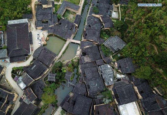 Aerial photo taken on Oct. 21, 2020 shows a view of the home inns in Longtan Village of Pingnan County in Ningde City, southeast China's Fujian Province. Longtan Village had been a provincial-level poverty-stricken village due to lack of arable land. Villagers went out for work one after another with many old buildings left in disrepair. In 2017, the county government launched a project to boost ancient villages through cultural and creative industries. The old houses, once forgotten, have been connected to public utilities, reinforced and decorated inside, with the ancient appearance of the village remained. Moreover, the renaissance here has attracted many people and college graduates outside the village to work here. Nowadays, more and more people come to visit Longtan since the village has become popular on the Internet. (Xinhua/Wei Peiquan)