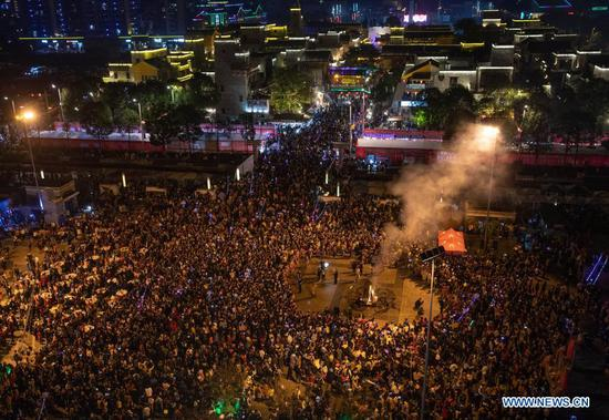 People dance around a bonfire at a square in Beichuan Qiang Autonomous County, southwest China's Sichuan Province, Nov. 14, 2020. A series of activities in celebration of the new year of the Qiang ethnic group kicked off in Beichuan on Saturday. (Xinhua/Jiang Hongjing)