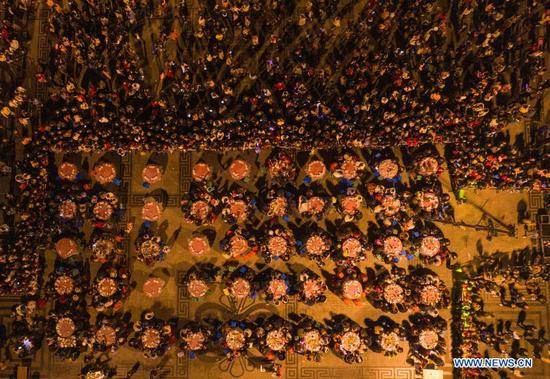 Aerial photo taken on Nov. 14, 2020 shows residents attending a group banquet at a square in Beichuan Qiang Autonomous County, southwest China's Sichuan Province. A series of activities in celebration of the new year of the Qiang ethnic group kicked off in Beichuan on Saturday. (Xinhua/Jiang Hongjing)