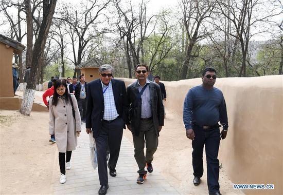 Foreign delegates to the first Shanghai Cooperation Organization (SCO) People's Forum visit a Revolutionary Site in Yan'an, northwest China's Shaanxi Province, April 11, 2018. The Forum was held from April 9 to 10 in Xi'an, capital of Shaanxi. (Xinhua/Chen Yehua)