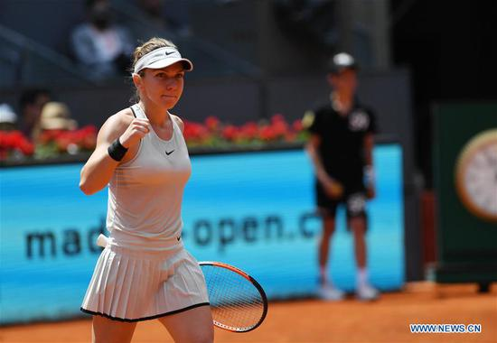 Simona Halep of Romania celebrates her victory after the women's individuals round 16 match against Kristyna Pliskova of the Czech Republic at the Madrid Open Tennis tournament in Madrid, Spain, May 9, 2018. Simona Halep won 2-0. (Xinhua/Guo Qiuda)